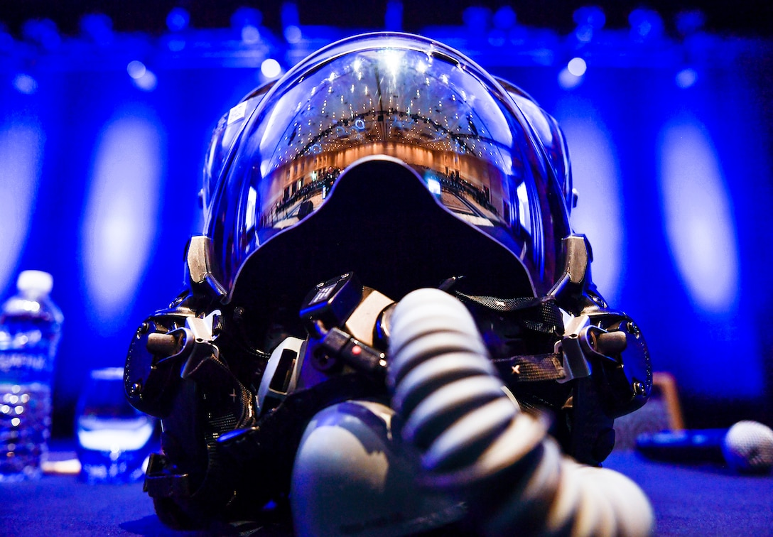 An F-35 Lightning II helmet sits on stage during the F-35 reaching initial operational capability panel discussion during the Air Force Association's Air, Space and Cyber Conference in National Harbor, Md., Sept. 20, 2016.  The F-35's helmet mounted display system is the most advanced system of its kind. All the intelligence and targeting information an F-35 pilot needs to complete the mission is displayed on the helmet's visor. (U.S. Air Force photo/Tech. Sgt. Anthony Nelson Jr.)