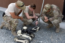 Explosive ordnance disposal Airmen from Joint Base Charleston, South Carolina, examine one of the three robots used in the EOD exercise, Sept. 14, 2016, at Seymour Johnson Air Force Base, North Carolina. The Airman were also accompanied by Marines from Camp Lejeune, North Carolina, during the exercise, and were able to participate in different EOD scenarios. (U.S. Air Force photo by Airman Miranda A. Loera)
