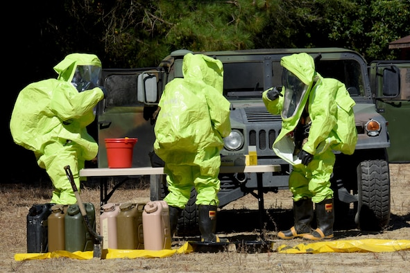 Three explosive ordnance disposal technicians from the 4th Civil Engineer Squadron, simulate a chemical spill and cleanup during a three-day EOD exercise, Sept. 15, 2016, on the EOD range at Seymour Johnson Air Force Base, North Carolina. The last day of the three-day exercise focused on chemical, biological, radiological and nuclear defense training. (U.S. Air Force photo by Airman Miranda A. Loera)