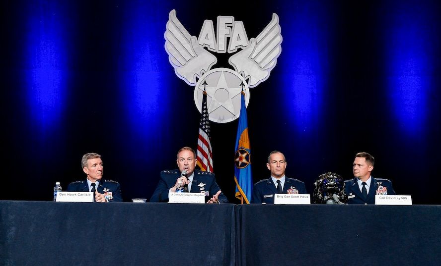 Gen. Hawk Carlisle, Lt. Gen. Christopher Bogdan, Brig. Gen. Scott Pleus and Col. David Lyons, speak during the F-35 Lightning II reaching initial operational capability panel discussion during the Air Force Association's Air, Space and Cyber Conference in National Harbor, Md., Sept. 20, 2016.  Carlisle is the Air Combat Command commander, Bogdan is the F-35 Lightning II Joint Program Office executive officer, Pleus is the F-35 Integration Office director, and Lyons is the 388th Fighter Wing commander. (U.S. Air Force photo/Tech. Sgt. Anthony Nelson Jr.)