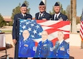 Three generations of U.S. Air Force master sergeants are represented in a painting and in real life in front of Bldg. 1 Sept. 16. From left: retired Master Sgt. Derrell Willson, retired Master Sgt. Derrell Willson II, and now retired Master Sgt. Derrell Willson III. Willson III retired Sept. 16 ending almost 65 years of continuous service to the U.S. Air Force from the Willsons. (U.S. Air Force photo by Joseph Gocong)