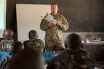 U.S. Army Sgt. 1st Class Charles Lewellen, 1st Battalion, 124th Infantry Regiment and noncommissioned officer in charge of training, shows how to assemble the AeroVironment RQ-11 Raven, an unmanned aerial vehicle, to members of the Kenyan Defense Force, Sept. 13, 2016, at a Kenyan training facility. The 1/124th Inf. Rgt. provided basic training on assembly, disassembly, repair, and preventative maintenance in regard to basic mission planning and advanced flight plans for the Raven to members of the KDF Military Intelligence Battalion. Air Force photo by Staff Sgt. Tiffany DeNault