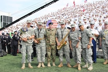 MG Wayne W. Grigsby with 1ID Band members.  1st Infantry Division Band was invited to perform with the West Point Band at a home football game Sept. 10, 2016 against Rice Universtity, where the 1ID was honored at the game.