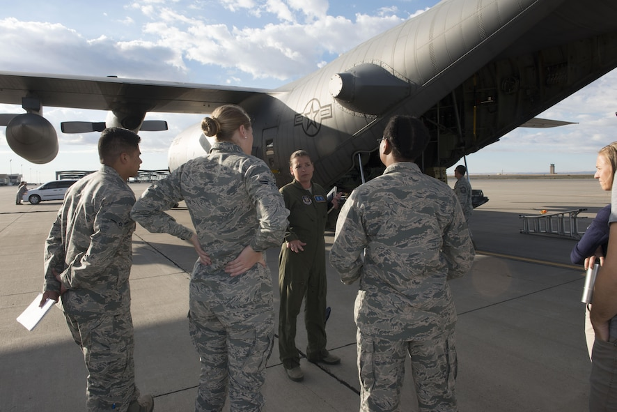 Maj. Jen Remmers, 910th Air Wing aerial spray team pilot, explains their mission of the aerial spray team, September 19, 2016, at Mountain Home Air Force Base, Idaho. A group of individuals from the 366th Civil Engineer Squadron and the Aerospace Medicine Squadron bioenvironmental flight had the opportunity to tour the C-130 and hear about its capabilities. (U.S. Air Force photo by Senior Airman Malissa Lott/Released)