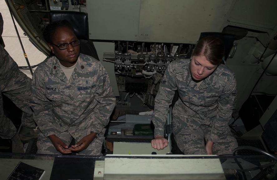 Maj. Venita Ramirez, 366th Aerospace Medicine Squadron public health flight commander, and Airman 1st Class Kiana Platte, 366th AMDS bioenvironmental engineering technicians, look at a control panel during a tour Sept. 19, 2016, at Mountain Home Air Force Base, Idaho. The C-130 is part of the 910th Air Wing stationed at Youngstown, Ohio. (U.S. Air Force photo by Senior Airman Malissa Lott/Released)