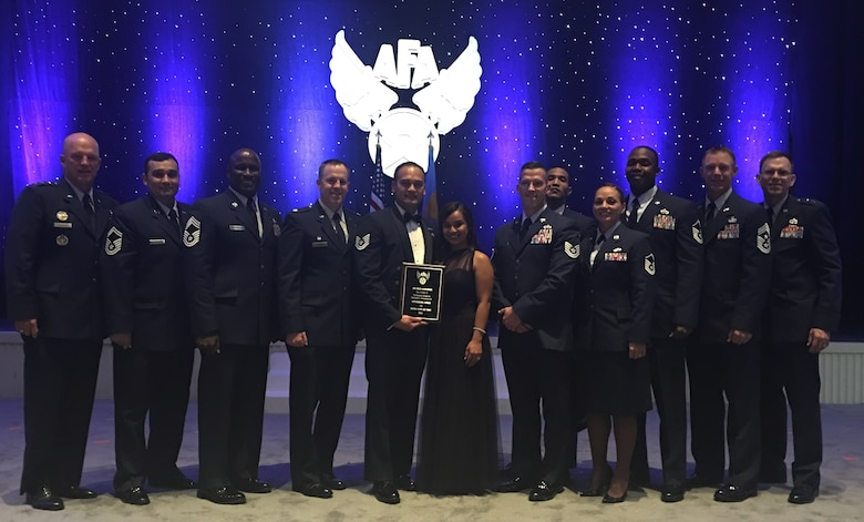 Tech. Sgt. Michael Asuncion Jr., 45th Civil Engineer Squadron Pavement and Equipment Craftsman, (holding award), was named one of the 12 Outstanding Airmen of the Year for 2016, for Air Force Space Command. Sept. 19, 2016, in Washington, D.C.  The Air Force Association proudly honored each Outstanding Airmen at its annual Air, Space & Cyber Conference held Sept. 19-21, 2016. (Courtesy photo)