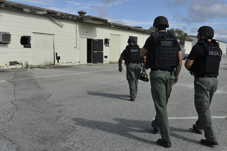 Detective Carl Makins (left), Master Deputy James Thomas and Detective Rob Smith, hazardous device technicians with the Charleston County Sheriff's Office, proceed to a cleared scene during a training exercise at Joint Base Charleston, South Carolina, Sept. 16, 2016. Makins is also a master sergeant in the 315th Airlift Wing reserve unit as an explosive ordnance disposal technician.
