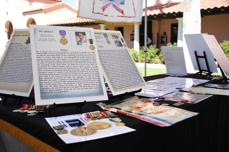 Prisoner of war memorabilia is displayed during a POW/MIA recognition ceremony at the Veterans Affairs main campus in Tucson, Ariz., Sept. 16, 2016. Tucson veterans who were captured during World War II, Vietnam and the Korean War provided memorabilia from their experiences as POWs to be displayed during the ceremony. (U.S. Air Force photo by Senior Airman Cheyenne A. Powers)