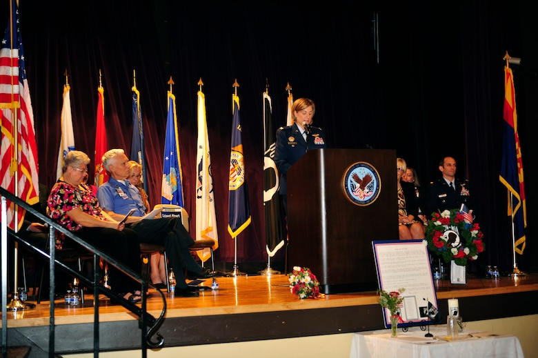 U.S. Air Force Col. Jennifer Short, 355th Fighter Wing vice commander, speaks during a POW/MIA recognition ceremony at the Veterans Affairs main campus in Tucson, Ariz., Sept. 16, 2016. The ceremony was held in honor of prisoners of war and those who are still missing in action. (U.S. Air Force photo by Senior Airman Cheyenne A. Powers)