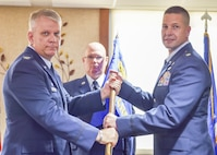 Maj. Robert Wengerter, new commander of the 910th Logistics Readiness Squadron, receives a unit guidon, or flag, from Col. Donald Wren, 910th Mission Support Group commander here, Sept. 10, 2016. Wengerter assumed command of his new squadron at a ceremony during the Unit Training Assembly (UTA). (U.S. Air Force photo/Staff Sgt. Rachel Kocin)