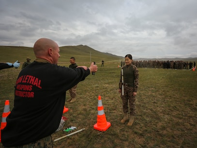 U.S. Marine Staff Sgt. Joseph Ross sprays a Mongolian Armed Forces soldiers with oleoresin capsicum during Non-Lethal Weapons Executive Seminar (NOLES) 2016 at the Five Hills Training Area, Mongolia, Sept. 17, 2016. Ross is a platoon sergeant with 1st Platoon, A Company, 3rd Law Enforcement Battalion, III Marine Expeditionary Force.  Mongolian soldiers and National Police were exposed to oleoresin capsicum spray and had to complete a five-level circuit course. Non-lethal weapons are designed to incapacitate equipment and personnel while minimizing fatalities and permanent injury to personnel, and undesired collateral damage to property.(U.S. Marine Corps photo by Cpl. Jonathan E. LopezCruet)