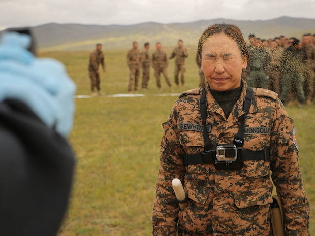 A U.S. Marine sprays Mongolian Armed Forces Junior Sgt. Battsend Enkhtuya with oleoresin capsicum during Non-Lethal Weapons Executive Seminar (NOLES) 2016 at the Five Hills Training Area, Mongolia, Sept. 17, 2016. Mongolian soldiers and National Police were exposed to oleoresin capsicum spray and had to complete a five-level circuit course. Non-lethal weapons are designed to incapacitate equipment and personnel while minimizing fatalities and permanent injury to personnel, and undesired collateral damage to property. (U.S. Marine Corps photo by Cpl. Jonathan E. LopezCruet)
