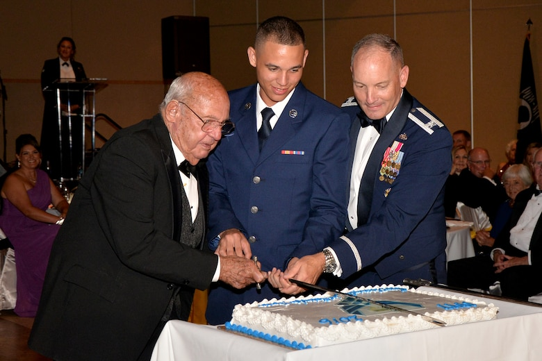 U.S. Air Force retired Col. Charles Powell, Airman Alex Bridgewater, 312th Training Squadron student, and Col. Michael Downs, 17th Training Wing Commander, cut a cake in celebration of the U.S. Air Force's 69th birthday during Goodfellow Air Force Base's Annual Air Force Ball at the McNease Convention Center in San Angelo, Texas, Sept. 16, 2016. It is a long-held tradition that the birthday cake is cut by the most senior member or veteran and youngest member present. (U.S. Air Force photo by Airman 1st Class Randall Moose/Released)