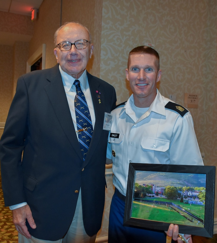Pennsylvania Army Reserve Ambassador George H. Duell, Jr. and Sgt. Maj. of the Army Daniel Dailey, pose for a photo at the Army Reserve Ambassador Forum, Sept. 16, 2016.  Duell, Dailey's high school principal, presented him with a framed photo of the Vietnam Moving Wall, which was located in Dailey's hometown of Palmerton, Pennsylvania.  (U.S. Army Reserve photo by Master Sgt. Marisol Walker/Released)