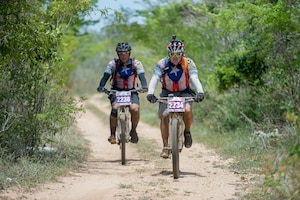 Iraqi Freedom veteran Army Staff Sgt. Carlos Labarca and Puerto Rico Army National Guard Staff Sgt. Juan Gonzalez ride a trail in a 100 kilometer mountain bike race in La Parguera, Puerto Rico Aug. 14, 2016. Labarca and Gonzalez rode with Warriors 4 Life nonprofit veterans group, which helps veterans cope with physical and psychological wounds and creates healthy lifestyles for them and their families. DoD photo by EJ Hersom