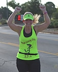 Tera Gibson, Hardin-Simmons University human resources director, raises her hands after finishing the 10K during the Dyess Mini Marathon, at Dyess Air Force Base, Texas, Sept. 17, 2016. The Dyess Fitness Center hosted the event on the same day as the Air Force Marathon in Wright Patterson AFB, Ohio to commemorate the Air Force's 69th birthday. (U.S. Air Force photo by Senior Airman Kedesha Pennant)