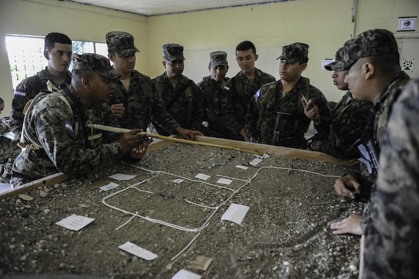 Honduran military members talk strategy before a practical exercise scenario in Tamara, Honduras, June 17, 2016. In October 2016, the Joint Task Force-Bravo command team will launch an initiative aimed at partnering with Honduran Armed Forces leadership to share concepts and approaches in order to further improve both nations' ability to develop today's and tomorrow's military leaders (U.S. Air Force photo by Staff Sgt. Siuta B. Ika)