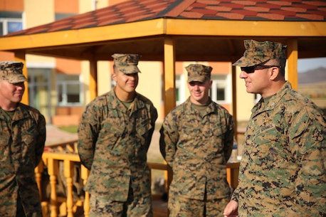 U.S. Marine Col. Peter Gadd, right, speaks to the Marines with 3rd Law Enforcement Battalion, III Marine Expeditionary Force, during Non-Lethal Executive Seminar (NOLES) 2016 at the Five Hills Training Area, Mongolia, Sept. 21, 2016. Gadd is the commanding officer of Headquarters and Service Battalion, U.S. Marine Corps Forces, Pacific. NOLES is an opportunity for all participating nations to enhance interoperability and strengthen military-to-military partnerships through cooperation.