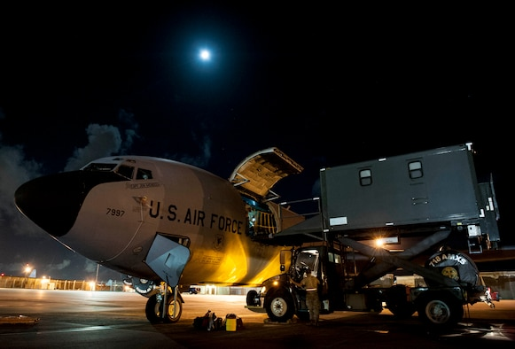 A U.S. Air Force 909th Air Refueling Squadron KC-135 Stratotanker receives 18th Aeromedical Evacuation Squadron cargo Sept. 12, 2016, at Kadena Air Base, Japan. The Stratotanker served as tanker support for Republic of Korea Air Force F-15 Eagles for a refueling exercise and as an aerial platform for 18th AES Airmen to perform a flight check of patient care procedures. (U.S. Air Force photo by Senior Airman Peter Reft)