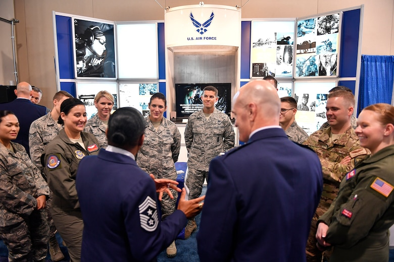 Airmen from Air Mobility Command discuss their experiences and military backgrounds with those attending the Air Force Association's Air, Space and Cyber Conference at National Harbor, Md., Sept. 20, 2016. Three major commands, Air Force Global Strike Command, AMC, and Air Education and Training Command were represented at the American Airman Booth. (U.S. Air Force photo/Tech. Sgt. Anthony Nelson Jr.)