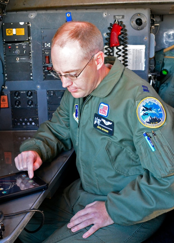 120th Airlift Wing Navigator Capt. Justin Hutchins works out a navigation problem during navigator training conducted in a C-130 Hercules transport aircraft parked on the 120th AW ramp in Great Falls, Mont. Sept. 15, 2016. (U.S. Air National Guard photo by Senior Master Sgt. Eric Peterson)