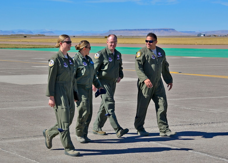 Navigators 2nd Lt. Tammy Wajer, Capt. Julie Glass, Capt. Justin Hutchins and Maj. Tirso Pena walk to a C-130 Hercules transport aircraft parked on the ramp of the 120th Airlift Wing in Great Falls, Mont. Sept. 15, 2016. Glass and Pena were training Wajer and Hutchins in navigation techniques in the aircraft. (U.S. Air National Guard photo by Senior Master Sgt. Eric Peterson)
