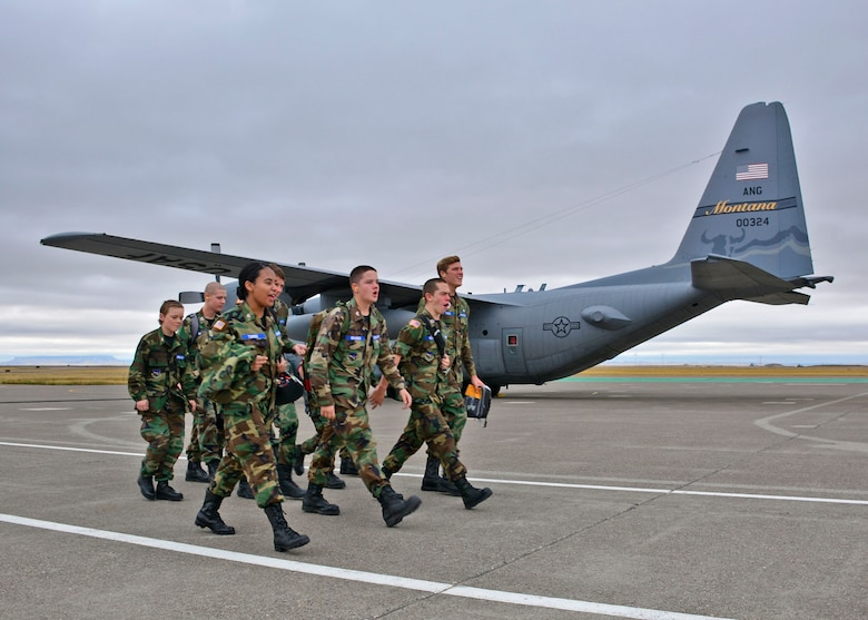 Civil Air Patrol cadets call cadence as they march to a C-130 Hercules transport aircraft assigned to the 120th Airlift Wing of the Montana Air National Guard. The cadets are assigned to the Malmstrom Air Force Base Composite Squadron of the Civil Air Patrol Montana Wing and were taking an orientation flight Sept. 13, 2016. (U.S. Air National Guard photo by Senior Master Sgt. Eric Peterson)