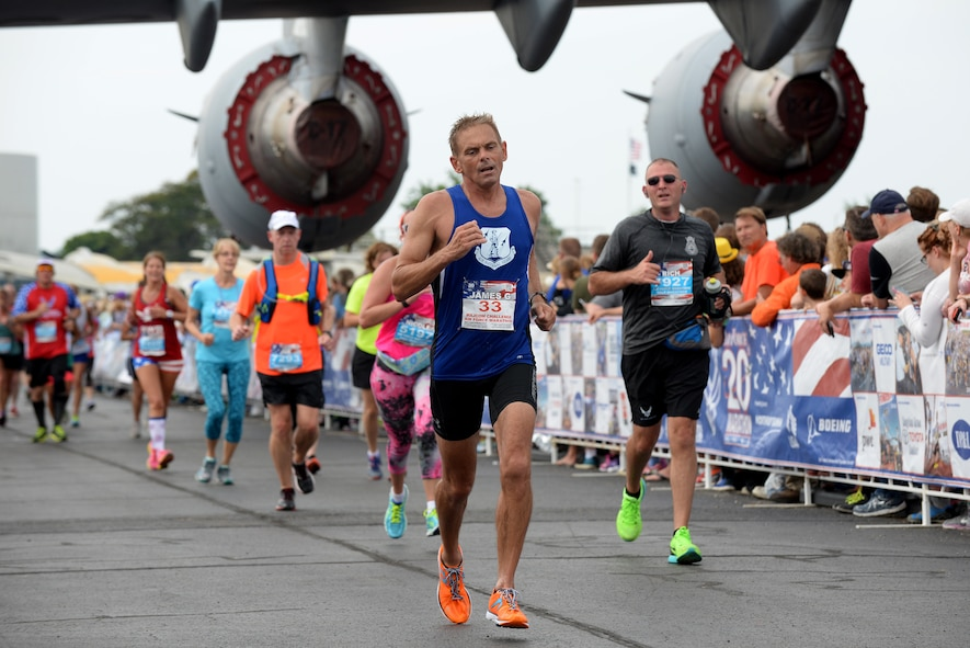 U.S. Air Force Maj. James Munnis, a pilot with the 167th Airlift Wing, West Virginia, races to the finish of the Air Force Marathon Sepetember 17, 2016, at Wright Patterson A.F.B, Ohio. Stewart competed for the Air National Guard marathon team in the MAJCOM Challenge. (U.S. Air National Guard photo by Senior Master Sgt. Ralph Branson/Released)