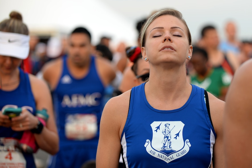 2nd Lt. Annelise Rowe, a security forces operations officer with the124th Fighter Wing , Idaho, tries to relax before the start of the Air Force Marathon Sepetember 17, 2016, at Wright Patterson A.F.B, Ohio. Rowe competed for the Air National Guard marathon team in the MAJCOM Challenge. (U.S. Air National Guard photo by Senior Master Sgt. Ralph Branson/Released)