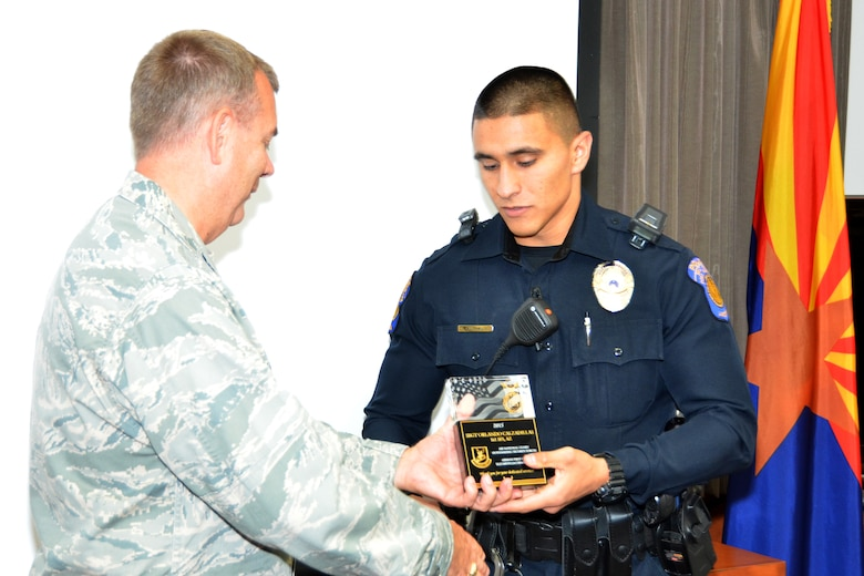 Col. Ed Kingdon, Air National Guard Security Forces director, presents the Airman First Class Elizabeth N. Jacobson Award to Staff Sgt. Orlando Calzadillas, a security forces journeyman assigned to the Arizona Air National Guard's 161st Air Refueling Wing in Phoenix, Sept. 14. Calzadillas, a full-time police officer for the Salt River Police Department, earned the award for outstanding performance while deployed to Southwest Asia in 2015. (U.S. Air National Guard photo by Tech. Sgt. Tony Taha)