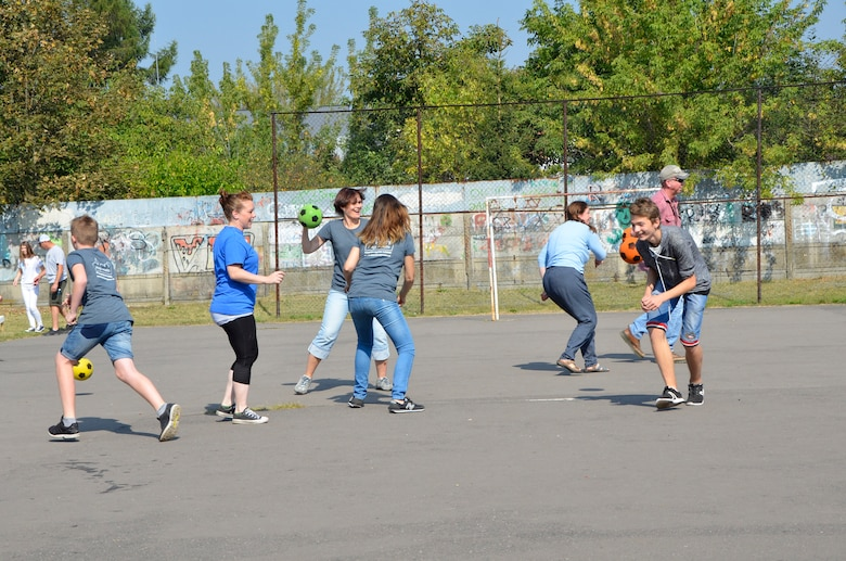 Konstantynow Lodzki, Poland - Students of Gimnazjum Nr 1 w Konstantynowie Lodzkim, a middle school in Konstantynow Lodzki, Poland, play a game of dodgeball Sept. 16, 2016. More than 50 members of the South Dakota Air National Guard, alongside members of the 52nd Operations Group Detachment 1, participated in a sports day at the school aimed at building relationships, teaching American sports and practicing English with the students. (U.S. Air National Guard photo by Capt. Amy Rittberger)