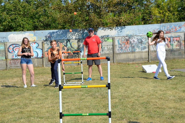 Col. Gregory Lair, 114th Fighter Wing vice commander, teaches students how to play ladder golf at Gimnazjum Nr 1 w Konstantynowie Lodzkim, a middle school in Konstantynow Lodzki, Poland, Sept. 16, 2016. More than 50 members of the South Dakota Air National Guard, alongside members of the 52nd Operations Group Detachment 1, participated in a sports day at the school aimed at building relationships, teaching American sports and practicing English with the students. (U.S. Air National Guard photo by Capt. Amy Rittberger)