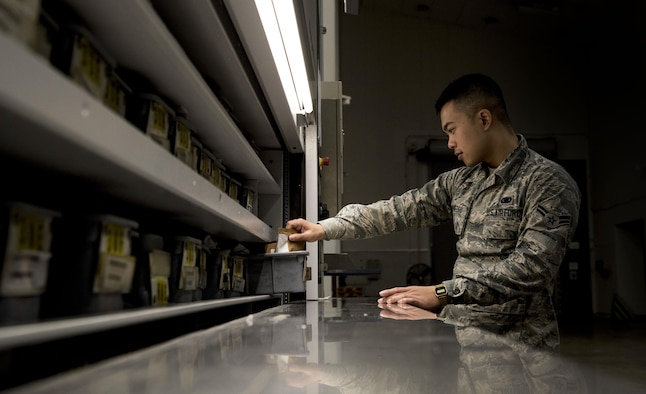 U.S. Air Force Airman 1st Class Samuel San Pedro, an aircraft parts store apprentice with the 35th Logistics Readiness Squadron, inspects a bin of electric bushings at Misawa Air Base, Japan, Sept. 20, 2016. Inventory is conducted monthly to ensure all aircraft items are serviceable. (U.S. Air Force photo by Airman 1st Class Sadie Colbert)