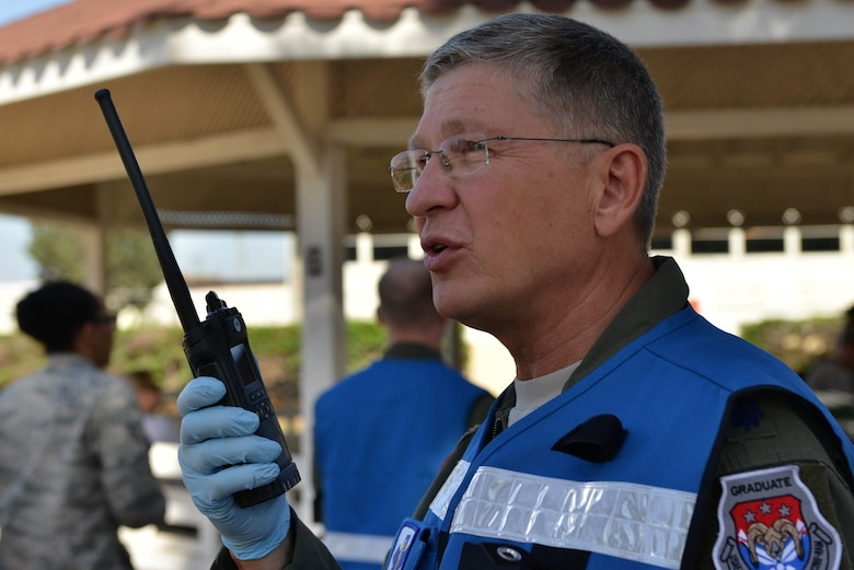 U.S. Air Force Lt. Col. Paul Puchta, 39th Medical Group chief of aerospace medicine, communicates over a land mobile radio (LMR) during a mass casualty exercise Sept. 21, 2016, at Incirlik Air Base, Turkey. LMRs allow quick responses for personnel in the field to communicate when separated. (U.S. Air Force photo by Senior Airman John Nieves Camacho)