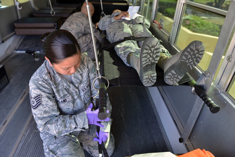 U.S. Air Force Tech. Sgt. Marinelle Bland, 39th Medical Operations Squadron medical admin, secures a simulated victim in a transportation vehicle during a mass casualty exercise Sept. 21, 2016, at Incirlik Air Base, Turkey. Airmen from the 39th Medical Group were tasked with responding to mass casualty scenarios and treating simulated injured personnel. (U.S. Air Force photo by Senior Airman John Nieves Camacho)