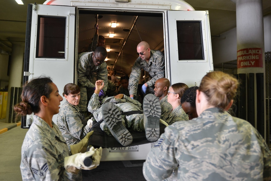 U.S. Airmen from the 39th Medical Group, receive a simulated victim from a transportation vehicle during a mass casualty exercise Sept. 21, 2016, at Incirlik Air Base, Turkey. In addition to their response, Airmen were tested on teamwork and leadership during the exercise. (U.S. Air Force photo by Senior Airman John Nieves Camacho)