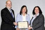 Philip Hepperle (left), director of equal employment opportunity for the Defense Contract Audit Agency, and DCAA Director Anita Bales (right) present a certificate of appreciation to Carmen Cantor (center), director of Ccivil Sservice human resource management for the U.S. State Department.