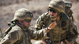 British Royal Marines discuss their scheme of maneuver during an assault on Range 205 as part of Exercise Black Alligator aboard the Marine Corps Air Ground Combat Center, Twentynine Palms, Calif., Sept. 13, 2016. Black Alligator, an annual training exercise, consists of approximately 1,000 British Royal Marines and 170 Dutch Royal Army soldiers who train aboard the installation in excess of 45 days to conduct relevant live-fire combined arms training, urban operations, and joint and coalition-level integration alongside more than 300 U.S. Marines consisting of artillerymen, engineers and tankers.