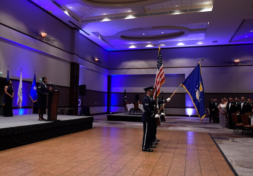 """Airmen from the Joint Base Charleston Honor Guard present the colors during the national anthem prior to the 2016 Air Force Ball, Sept. 17, 2016 at the Charleston Convention Center here. The theme for this year's event was, """"Profession of Arms: Forging the American Airman."""" The ball celebrated the people and events that shaped the Air Force through its 69-year history."""