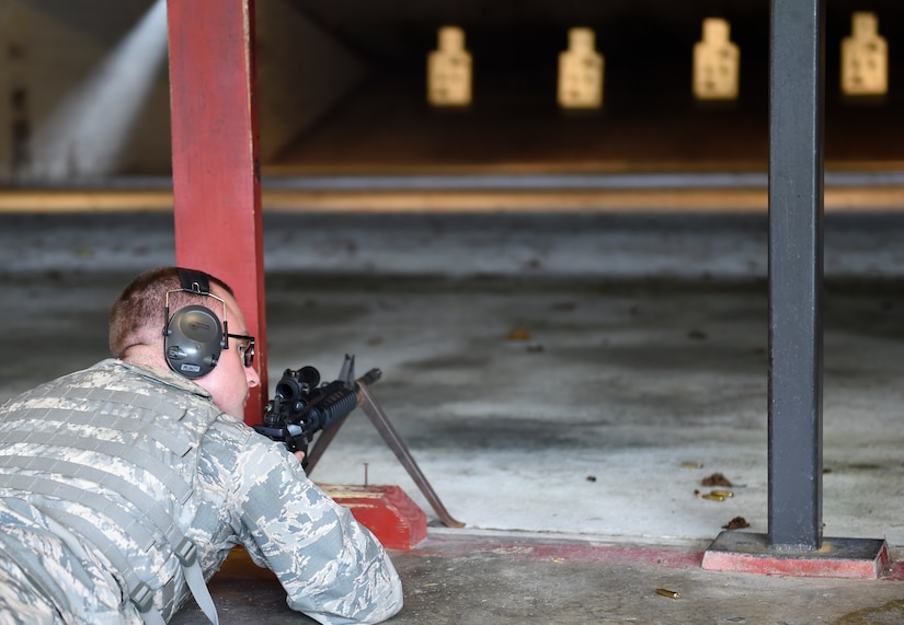 Senior Airman Nick Kanos, 437th Operations Support Squadron aircrew flight equipment technician awaits for the signal to fire the M4 rifle during a weapons qualification course here, Sept. 13, 2016. Airmen fired weapons as part of an M4 rifle qualification course in preparation for a deployment, permanent change of station move or as part of annual training.