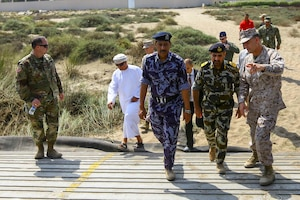 U.S. Marine Brig. Gen. Francis L. Donovan, Commanding General of Task Force 51 Naval Amphibious Force, and 5th Marine Expeditionary Brigade, and U.S. Army Col. Eric J. Larson, Defense Attache, escort officials with The Royal Omani Police during a bilateral non-combatant evacuation exercise at the U.S. Embassy, Muscat, Oman, Sept. 21, 2016. The non-combatant evacuation exercise is an opportunity for the United States and Oman to practice a bilateral mission of quickly providing security and safety to U.S. and international citizens abroad during a natural disaster or contingency.