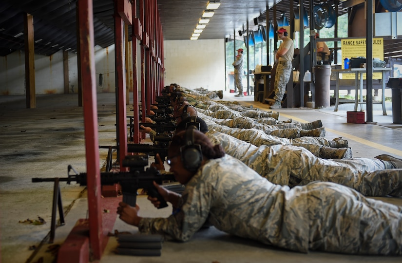 Airmen fire the M4 rifle at the firing range here, Sept. 13, 2016. Airmen fired weapons as part of an M4 rifle qualification course in preparation for a deployment, permanent change of station move or as part of annual training.