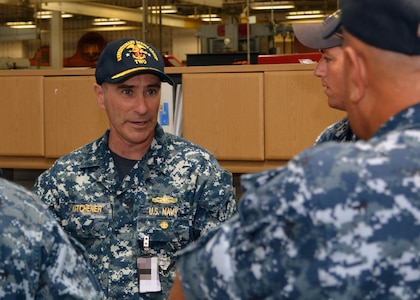Rear Adm. Roy Kitchener, Commander, Expeditionary Strike Group 2, interacts with Sailors attached to Southeast Regional Maintenance Center's (SERMC) Pump Shop on Tuesday. Expeditionary Strike Group 2 was established in2006 as an integrated Navy and Marine Corps Staff  and is responsible for the Iwo Jima Amphibious Ready Group (IWOARG) which consists of USS Iwo  Jima (LHD 7), USS New York (LPD-21) and USS Fort McHenry (LSD 43).