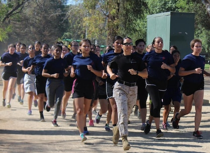 Recruiting Station Los Angeles' Commanding Officer Maj. Aixa R. Dones, leads future Marines on a motivational run during the quarterly future Marine function at the Sherman Oaks Park in Van Nuys, Calif., Sept. 10, 2016. (U.S. Marine Corps photo by Staff Sgt. Alicia R. Leaders/Released)