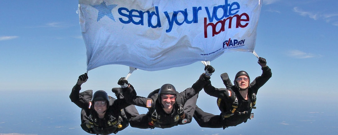 Members of the Army's Golden Knights parachute team pass on the Federal Voting Assistance Program's message for U.S. military and overseas citizens to submit their absentee ballots in time for the upcoming general election. DoD photo