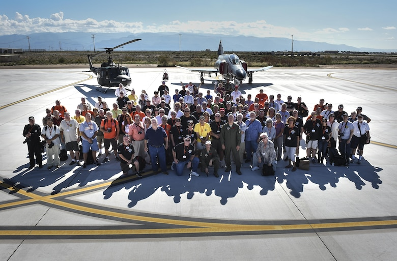 All 160 Phantom Society participants pose for a picture Sept. 13, 2016, at Holloman AFB. The Phantom II society is an international non-profit dedicated to the preservation of the history of the McDonnell Douglas F-4 Phantom II fighter. The tour enabled aircraft enthusiasts, including veterans and non-veterans with aviation backgrounds, to explore various base locations. The tour included an F-16 Fighting Falcon static and briefing, travel to Holloman's High Speed Test Track, the opportunity to view QF-4s and F-16s in flight, and a visit to Heritage Park to view statics displays of various aircraft flown at Holloman AFB. (U.S. Air Force Photo by SSgt Stacy Jonsgaard)