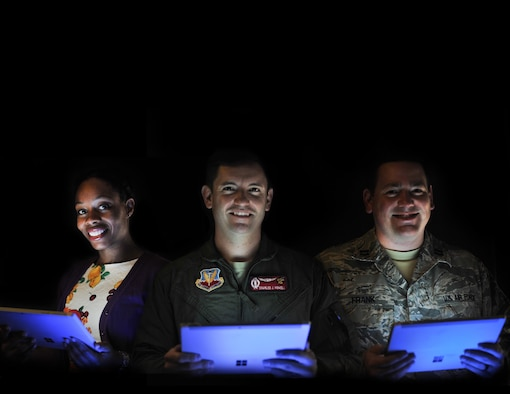 Dr. Danielle Cummings, Computer Systems Researcher, Capt. Charles Howell, and Capt. Ryan Frank, Special Missions Flight, 707th Communications Squadron, hold working prototypes of the Assisted Messaging Processing Tool (AMPT) E-Codebook on Sept, 9, 2016, at Ft. George G. Meade, Md. The AMPT E-codebook will streamline the encoding and decoding of messages delivered from the President of the United States to warfighter. (U.S. Air Force illustration/Staff Sgt. Alexandre Montes)