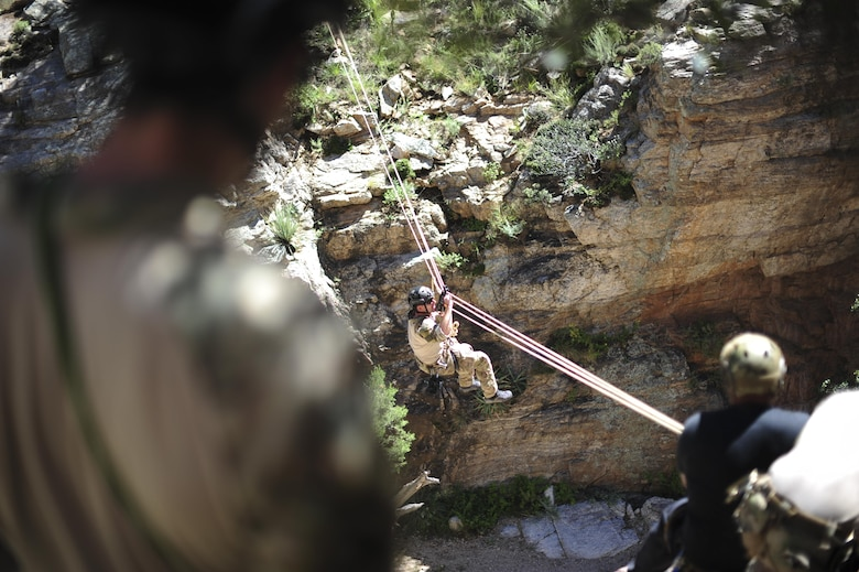 A pararescueman from the 48th Rescue Squadron traverses a ravine on a highline at the Coronado National Forest in Tucson, Ariz., Sept. 16, 2016. The 48th RQS deploys Guardian Angel forces worldwide in support of national security objectives and homeland defense. (U.S. Air Force photo by Airman Nathan H. Barbour)