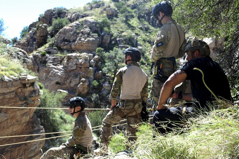 Pararescuemen from the 48th Rescue Squadron stand by for a team member to cross a ravine on a highline at the Coronado National Forest in Tucson, Ariz., Sept. 16, 2016. The 48th RQS deploys Guardian Angel forces worldwide in support of national security objectives and homeland defense. (U.S. Air Force photo by Airman Nathan H. Barbour)