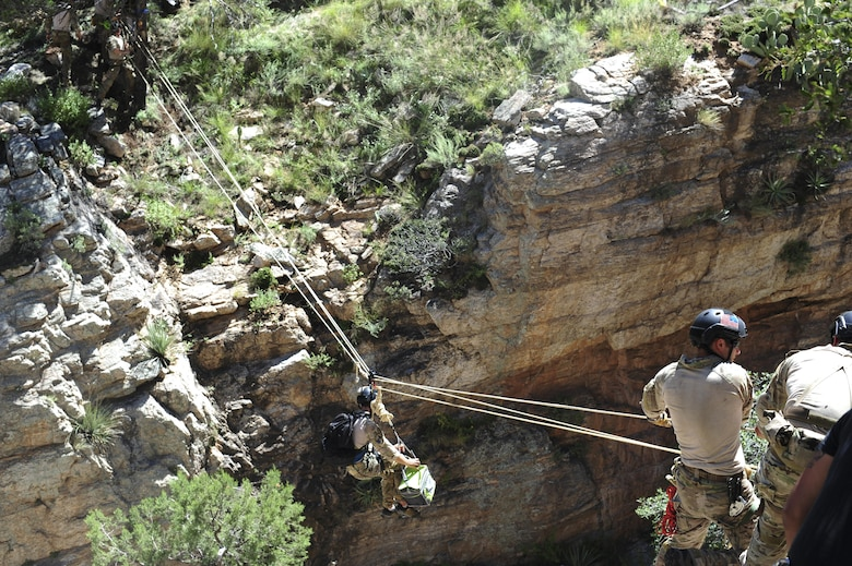 A pararescueman from the 48th Rescue Squadron traverses a ravine on a highline at the Coronado National Forest in Tucson, Ariz., Sept. 16, 2016. The 48th RQS recovery teams have saved hundreds of lives in combat and noncombat situations. (U.S. Air Force photo by Airman Nathan H. Barbour)